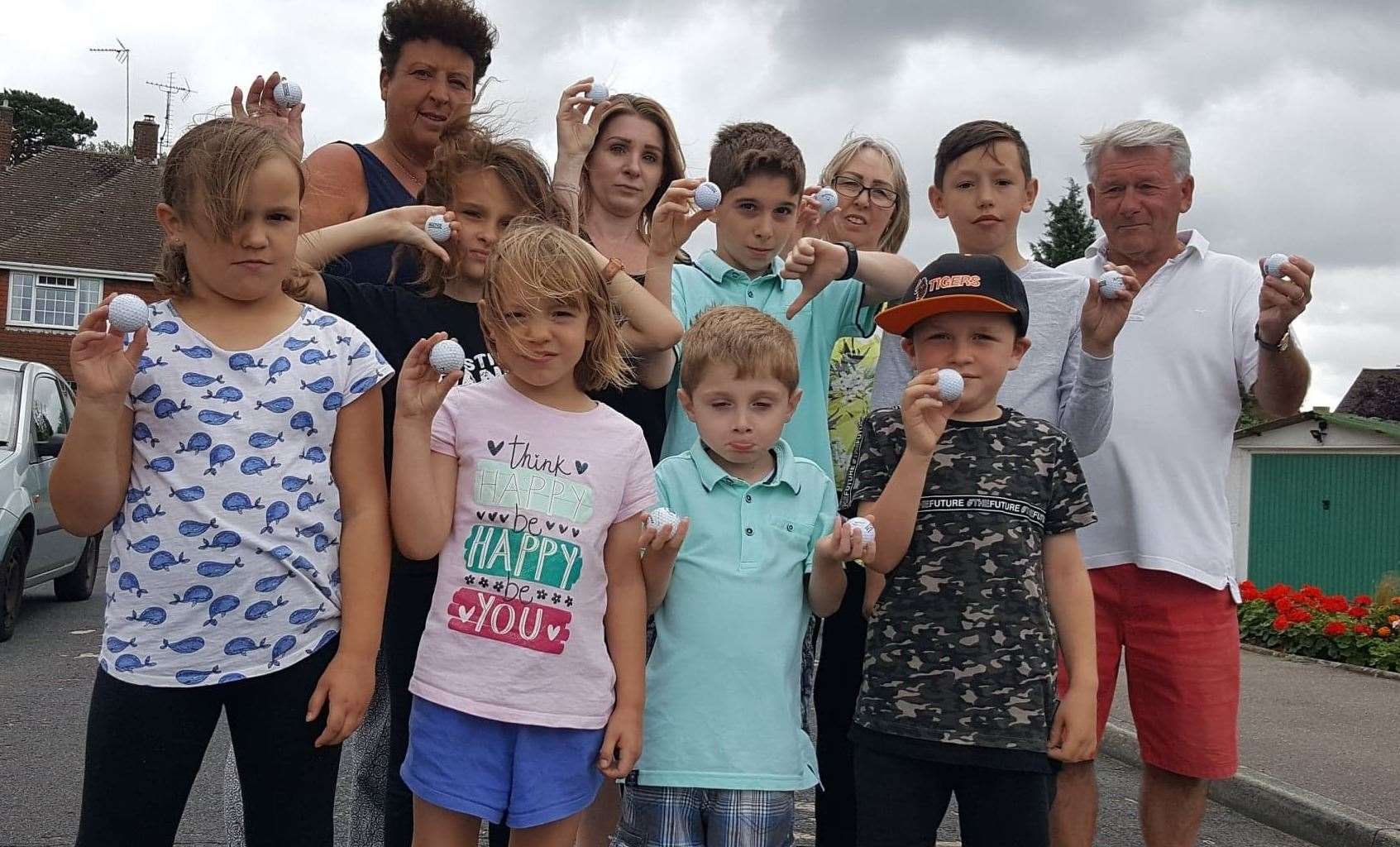 Residents are fed up with the flying golf balls; back row: Steff Plester, Lynsey Holmewood, Denise Austin and Malcolm Austin with children from the road