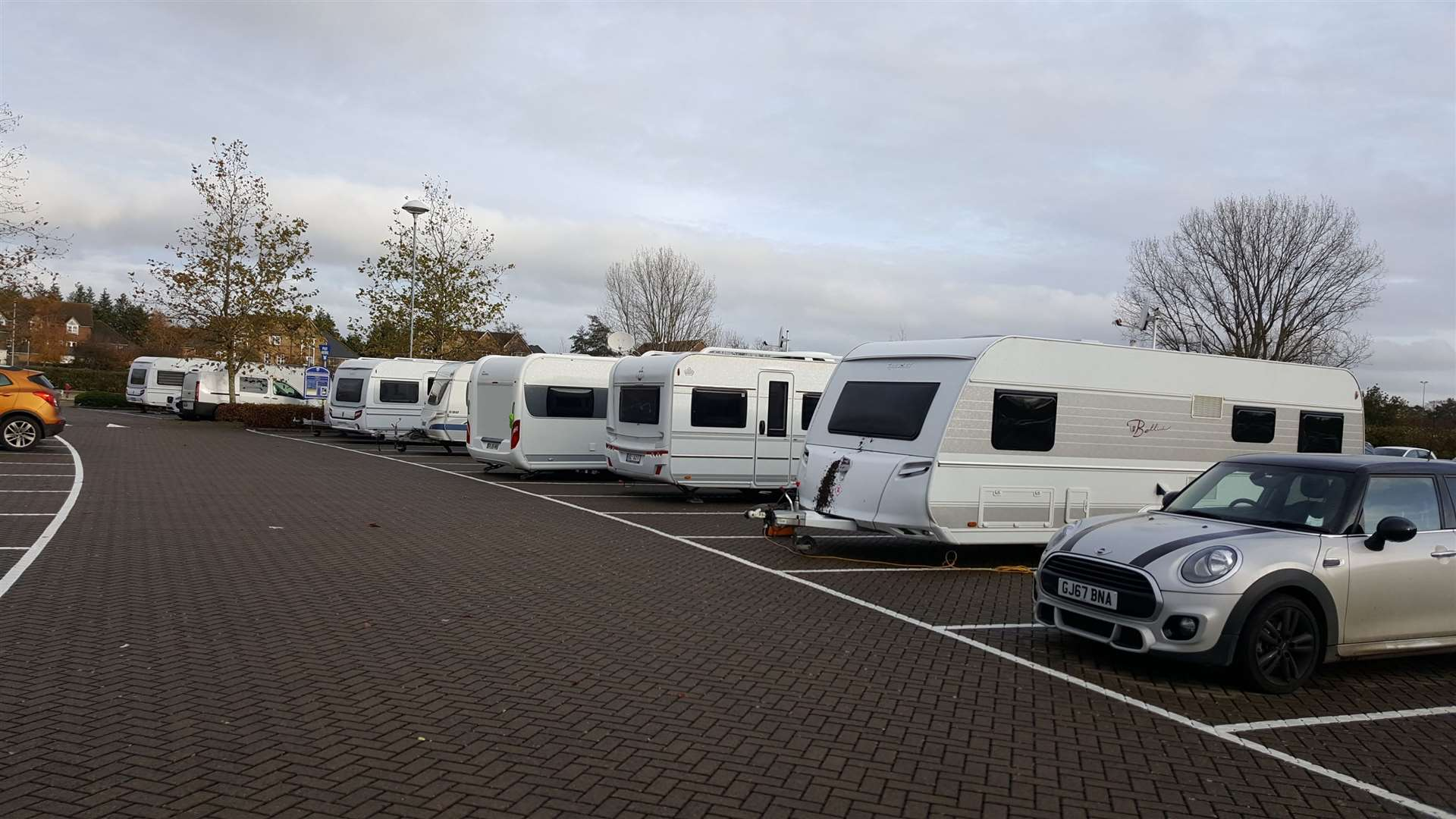 About 12 caravans have pitched up in the car park