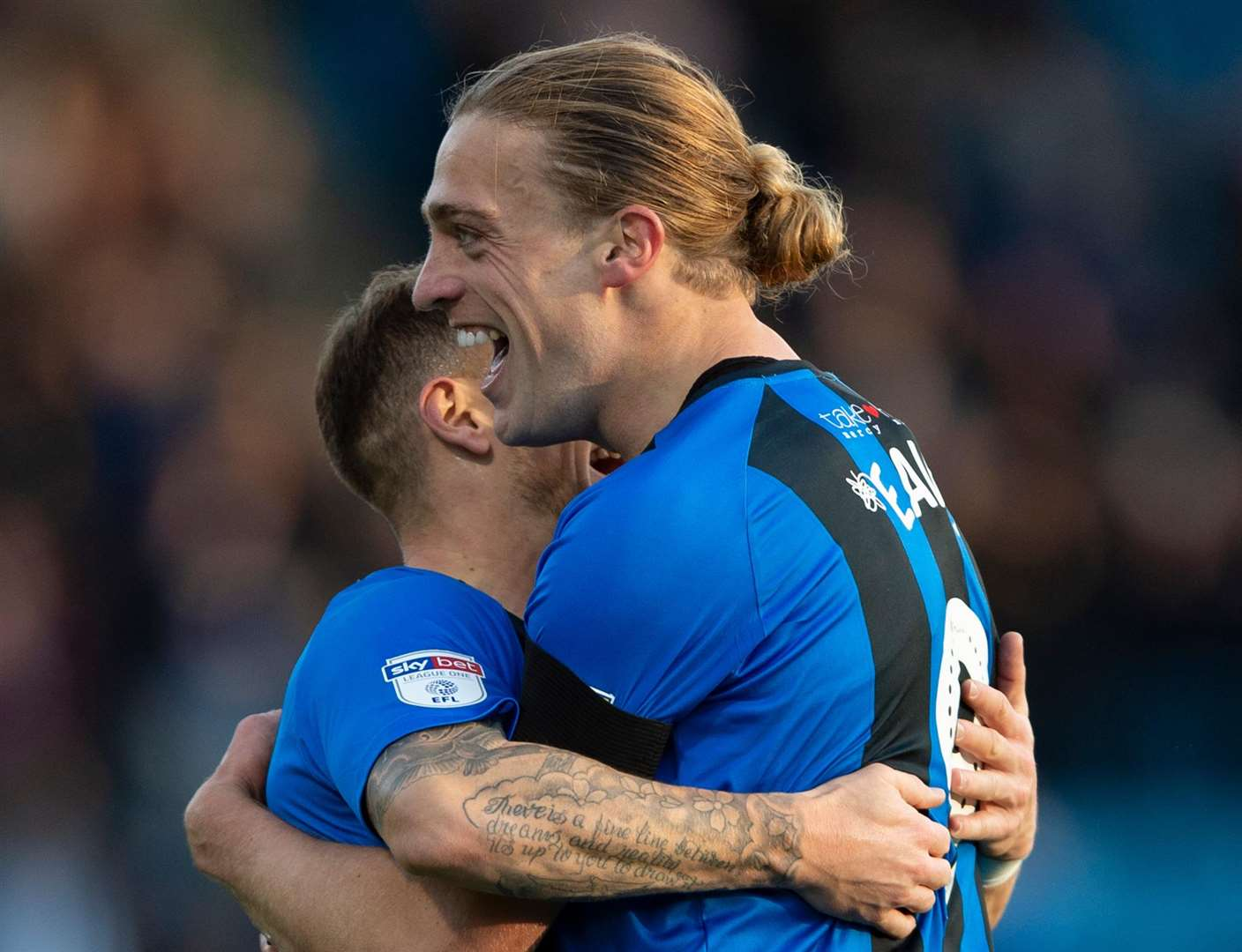 Tom Eaves celebrates scoring Gillingham's second goal with Mark Byrne Picture: Ady Kerry