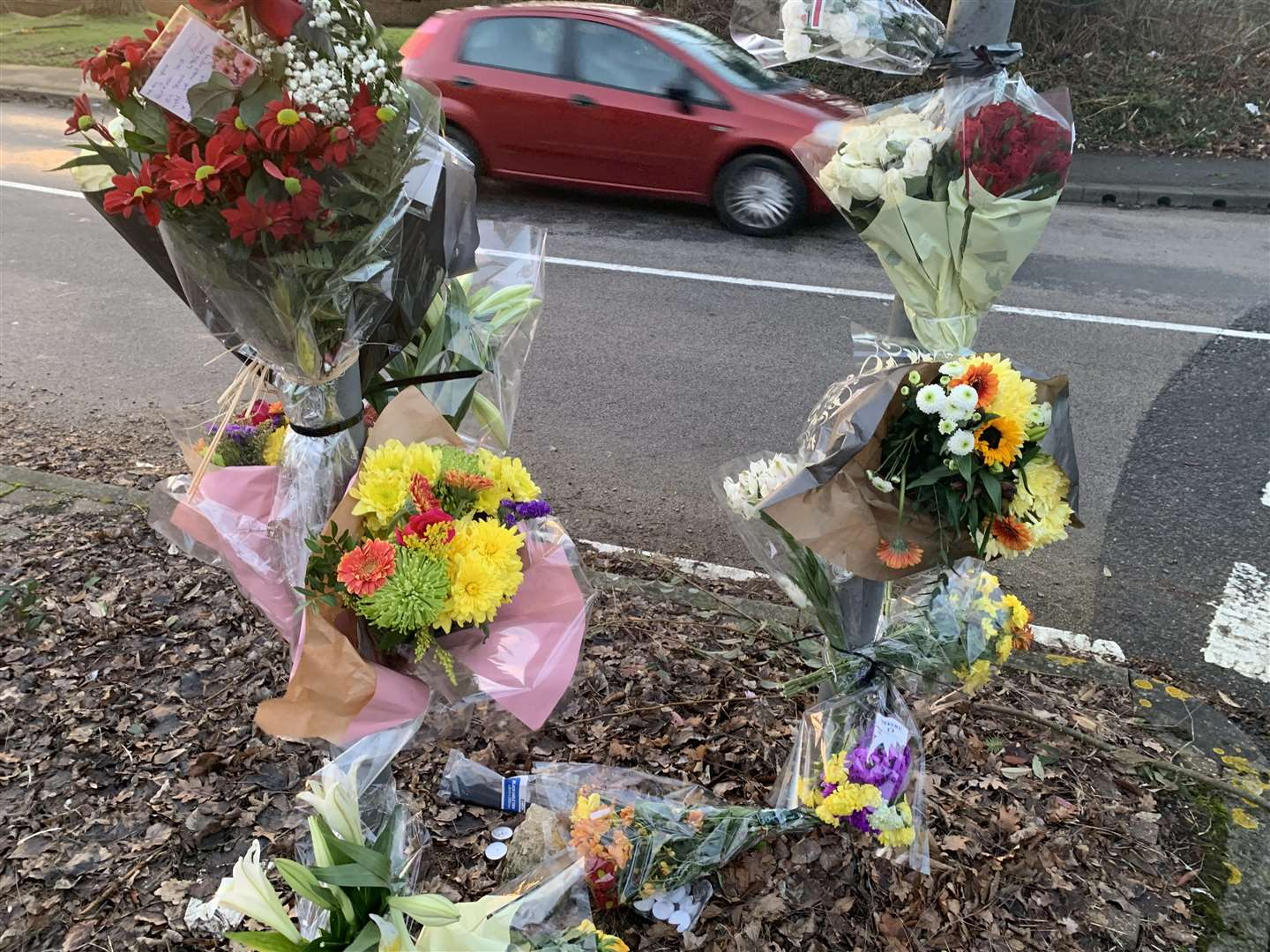 Floral tributes were left by a roundabout near where a man from Gravesend died
