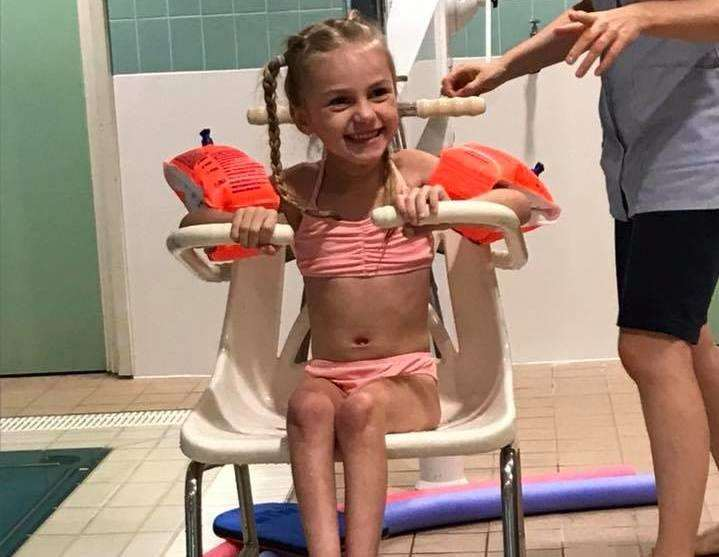 Ellice Barr waiting to go swimming as part of her physiotherapy