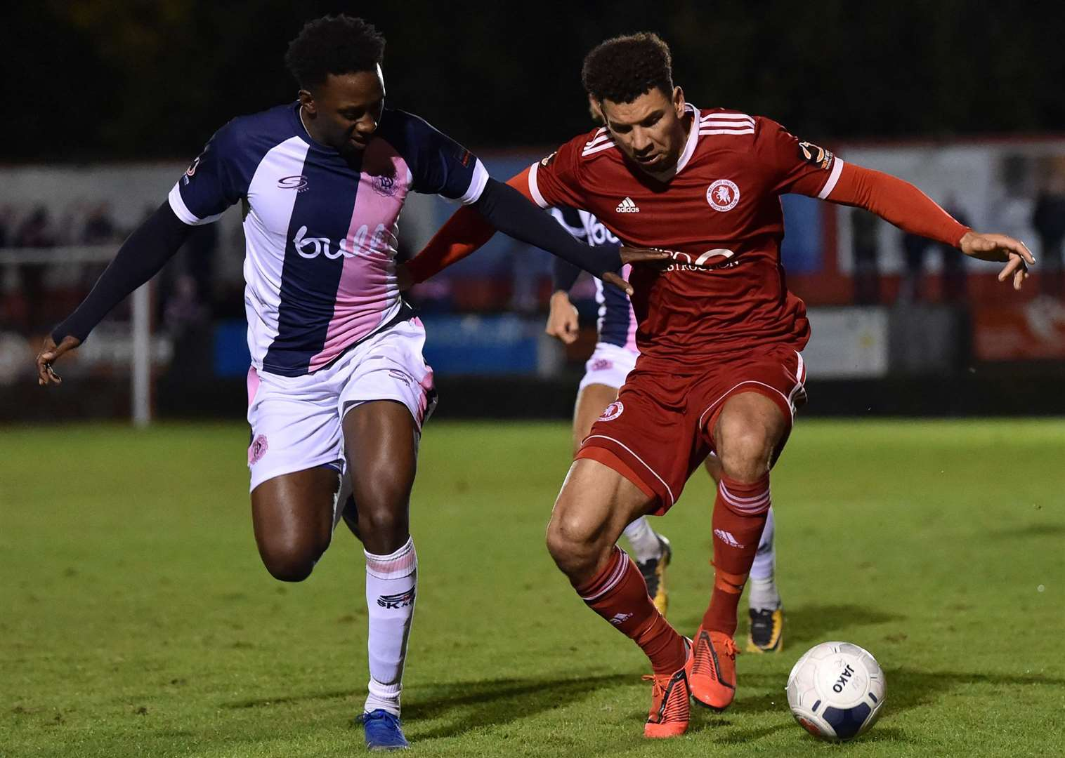 Welling's Nathan Green is closed down by Dulwich's Marvin McCoy. Picture: Keith Gillard