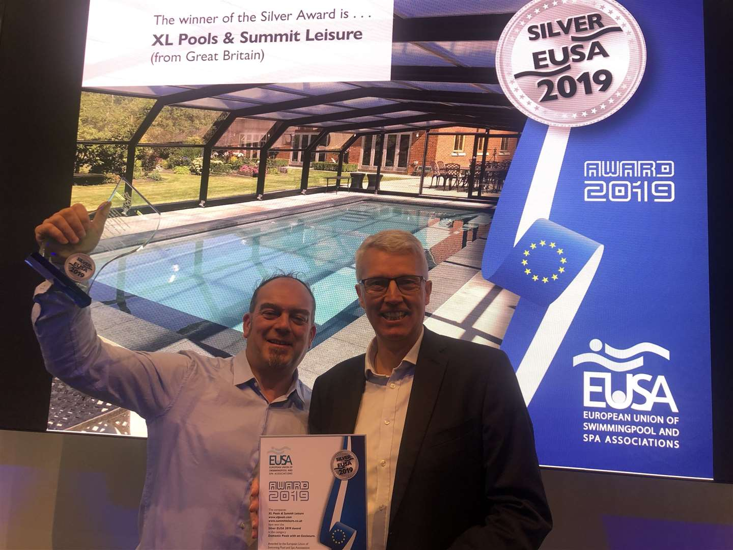 Anthony Exell, MD for XL Pools, with SPATA Managing Director Chris Hayes at the European award ceremony. The pool behind them was named the second best in Europe in the domestic pool enclosure category