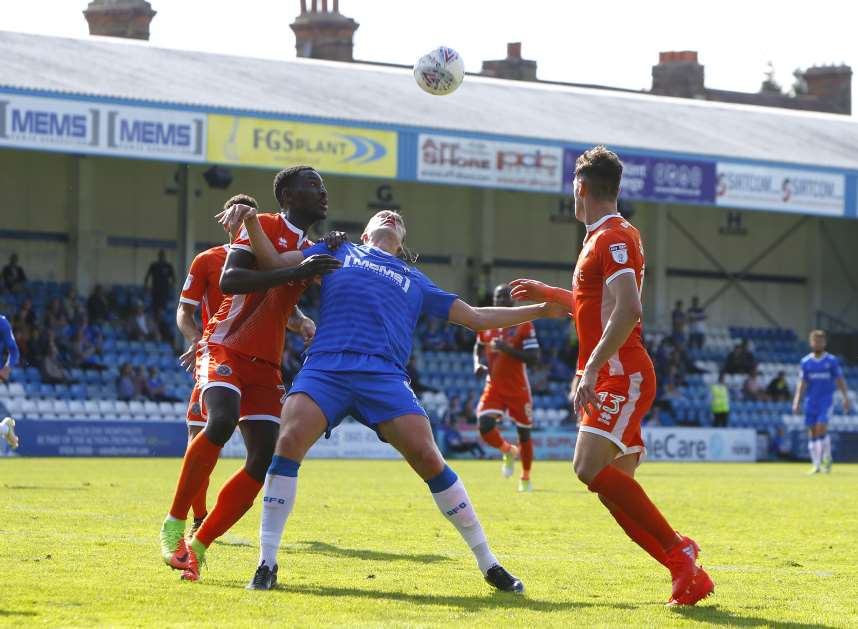 Gills striker Tom Eaves challenges for the ballPicture: Andy Jones