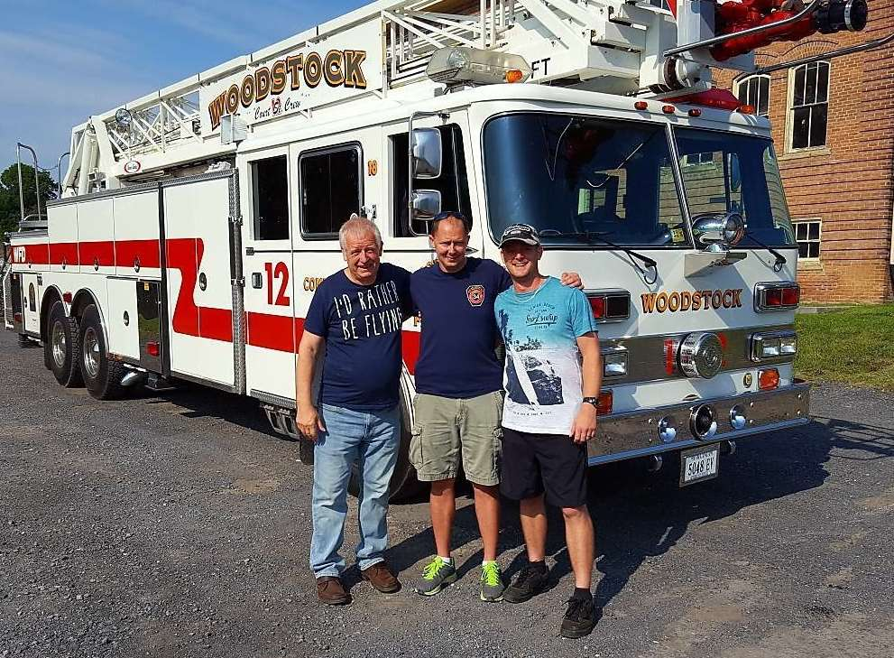 Bill Best, firefighter Adam Burner of Woodstock Fire Department in Virginia, and Bill's son, Richard Best, with the fire truck