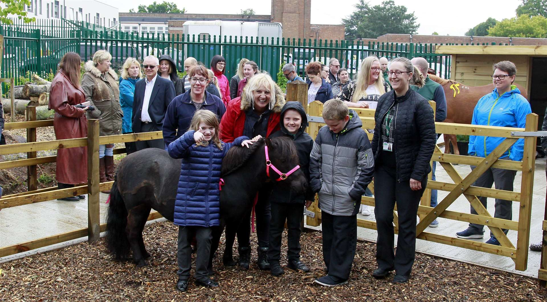Volunteers have built stables at the school visited today by ponies from LuLu Pony Parties, pictured Ellie 8, Joe 8 and Raymond from Woodpecker class with volunteers and parents and LuLu the pony.Picture: Sean Aidan (11918561)