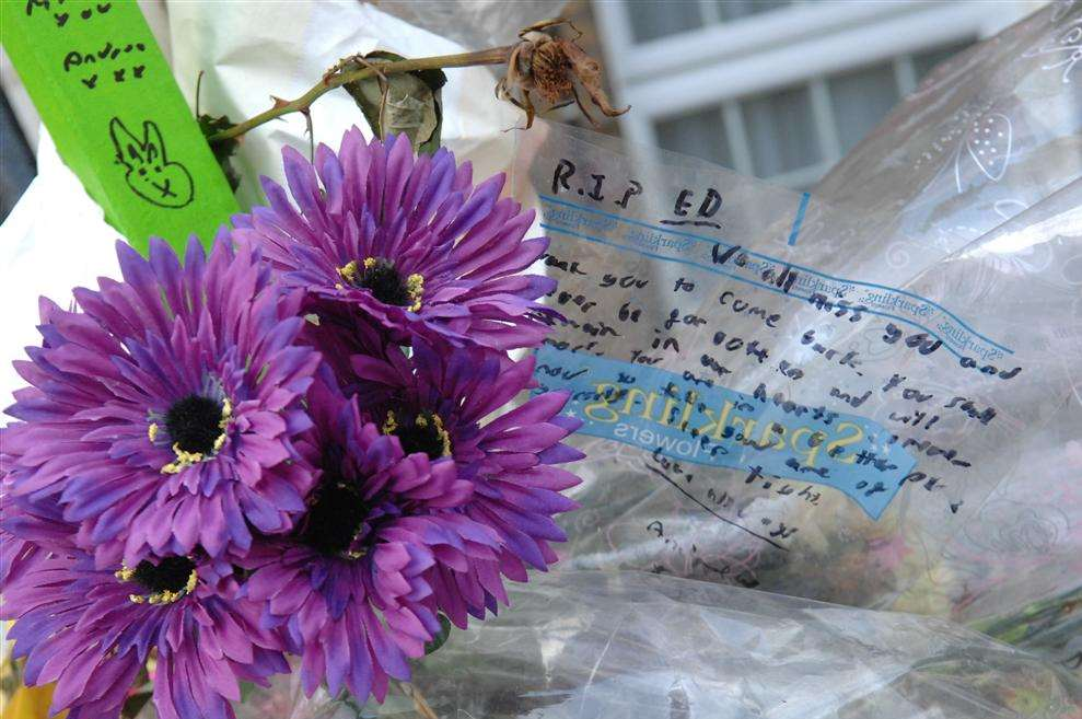 Flowers left outside the Gravesend flat where schoolboy Edward Barry was found dead