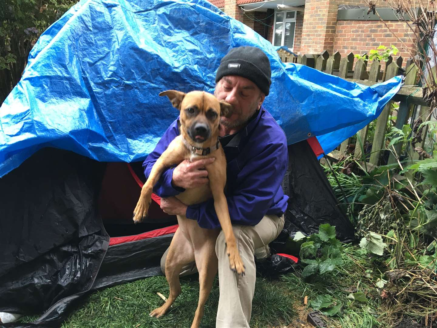 Paul Wallis and his dog Cali are sleeping in a tent after being evicted (9897876)