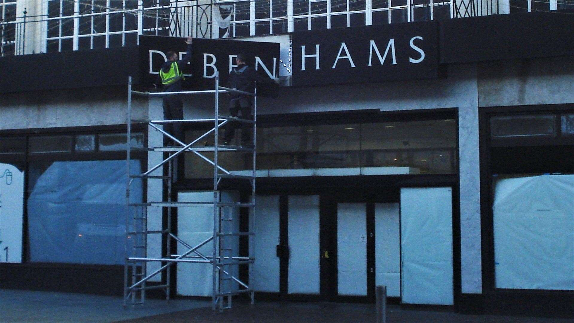 Workers remove the Debenhams sign at the Folkestone store, which closed on Sunday. Picture credit: Legends of Folkestone Facebook page