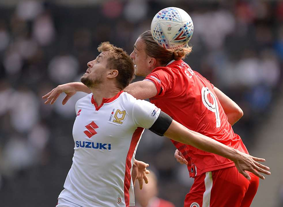 Gills striker Tom Eaves challenges for the ball Picture: Ady Kerry