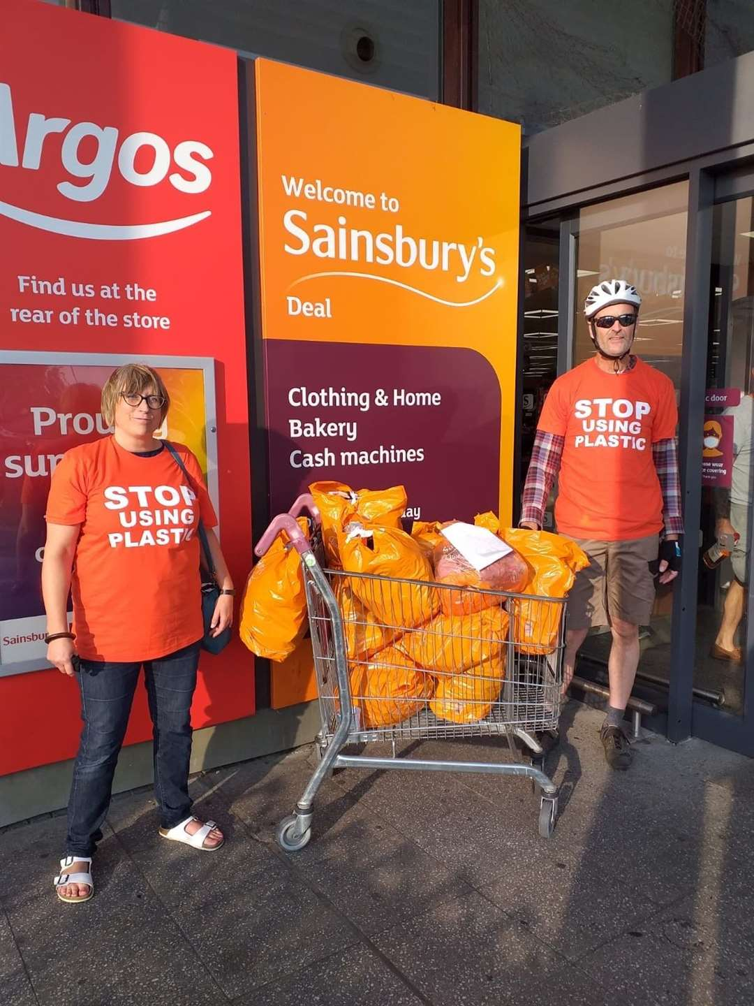 East Kent Climate Action presented a trolley of single use plastic items collected by a household of three people during lockdown to Sainsburys Picture: Helen O'Brien