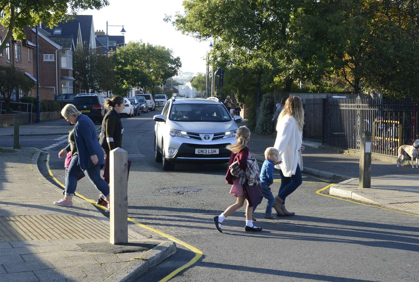 Families crossing Cromwell Road, outside Westmeads Community Infant school