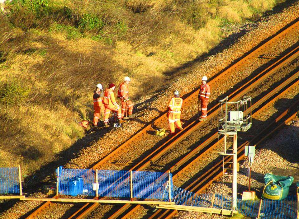Workmen inspect a section of the track. Picture: Samphire Hoe