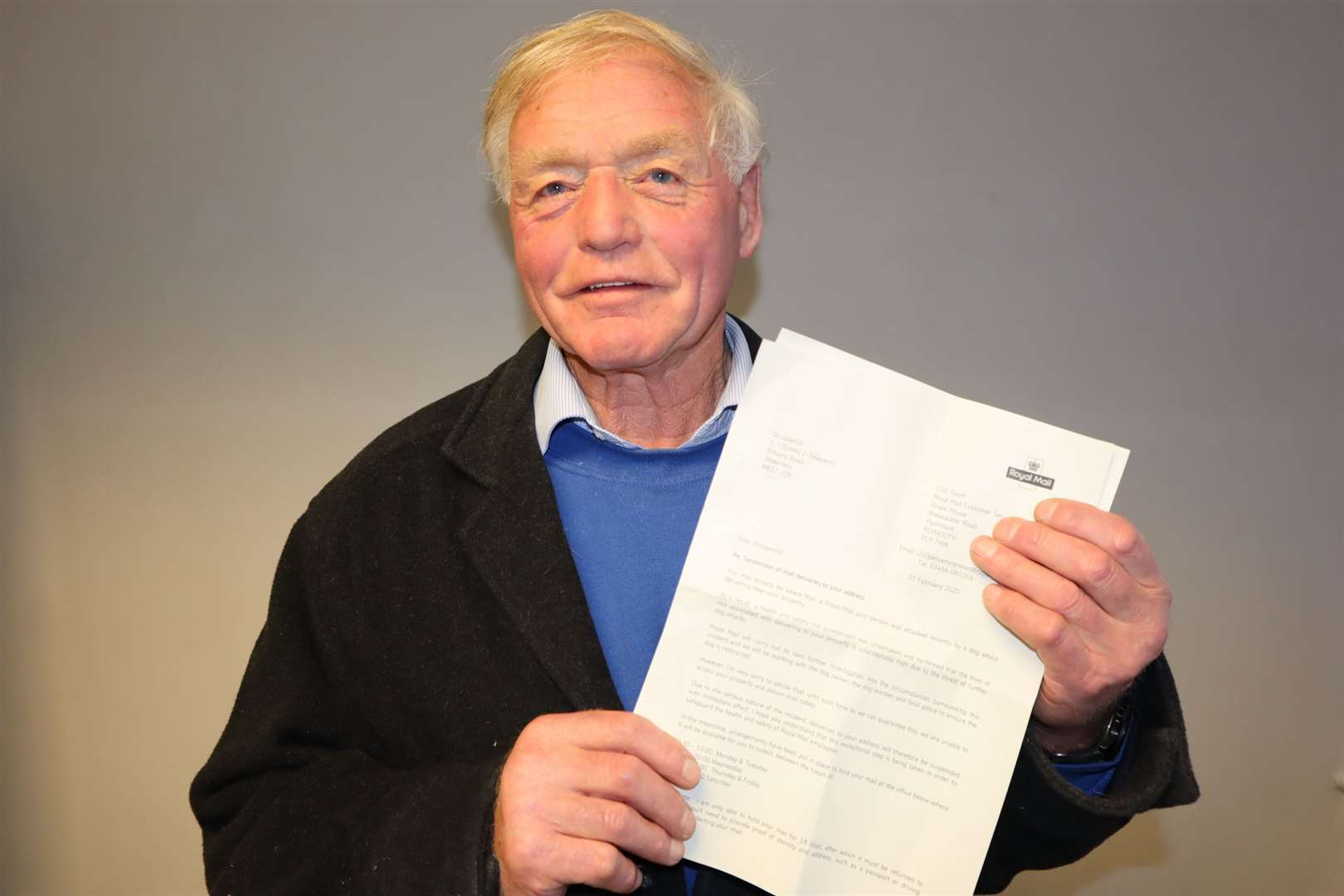 Butch Stanton with his letter from Royal Mail saying his postal service had been suspended
