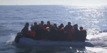 Nigel Farage's video shows the migrants crammed into a boat with water lapping over it yesterday