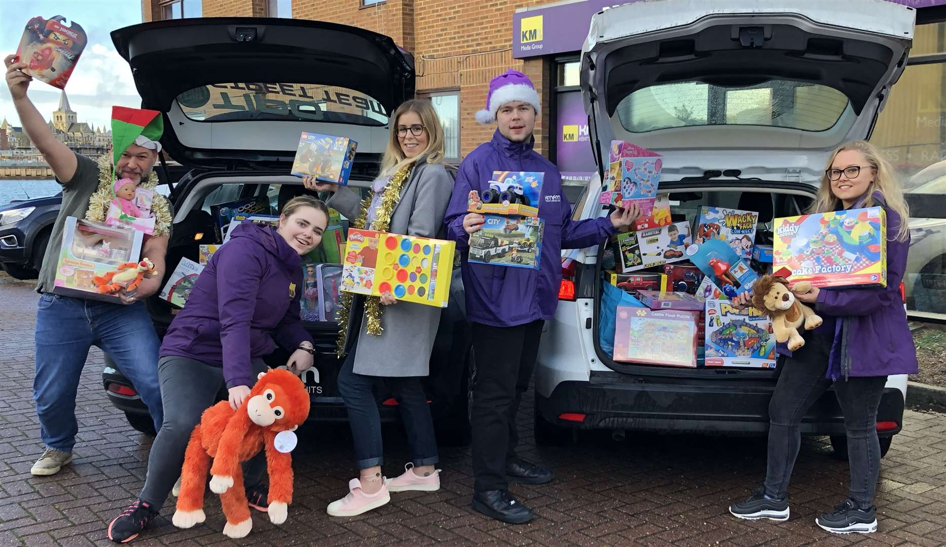The kmfm Street Team and breakfast show presenters Garry and Laura get ready to deliver toys last Christmas
