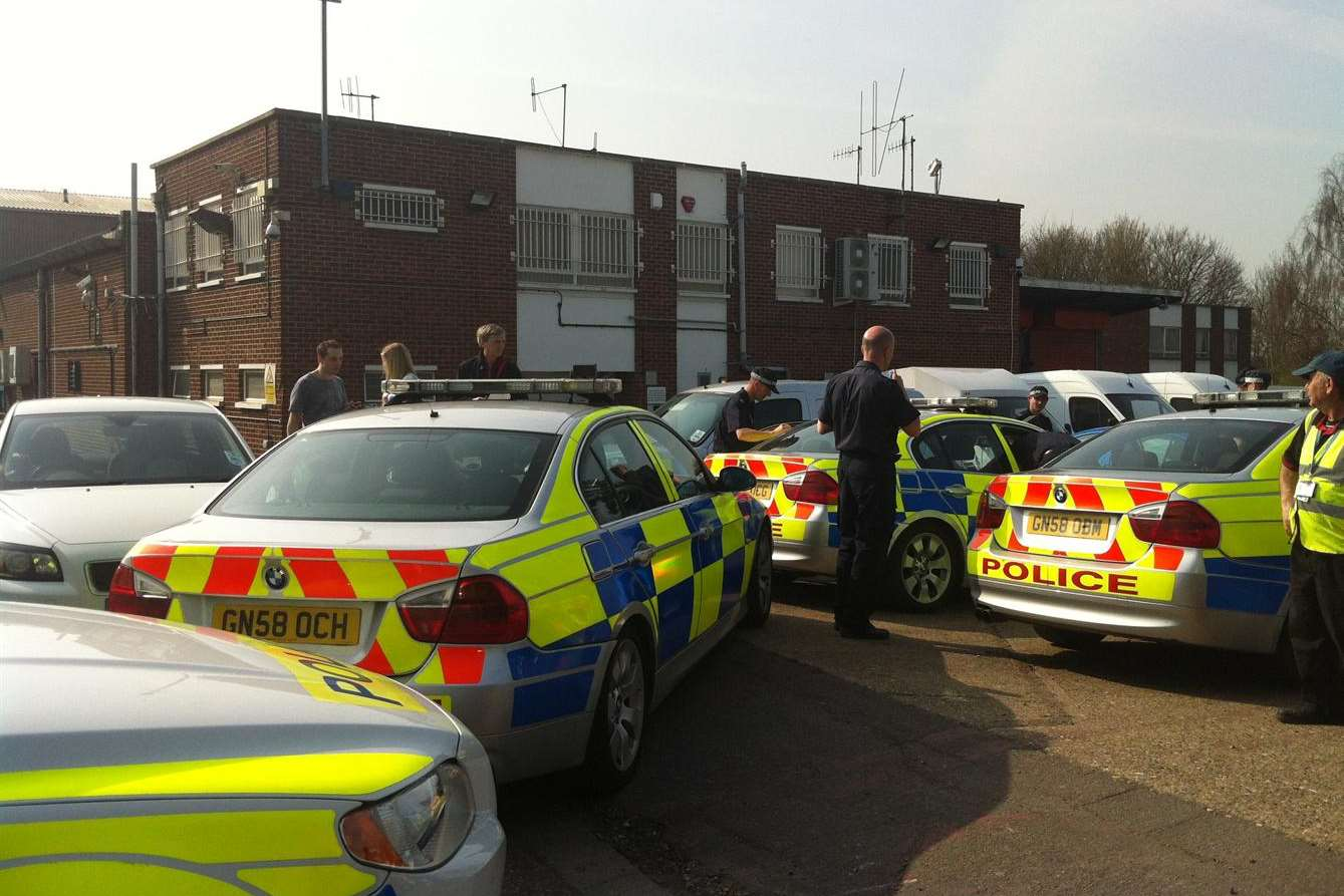 Dozens of police officers at the Loomis cash depot in Swanley
