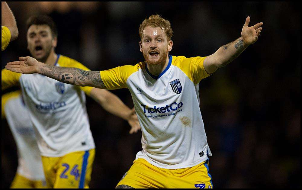 Connor Ogilvie appeals after Gillingham think they score Picture: Ady Kerry (6275021)
