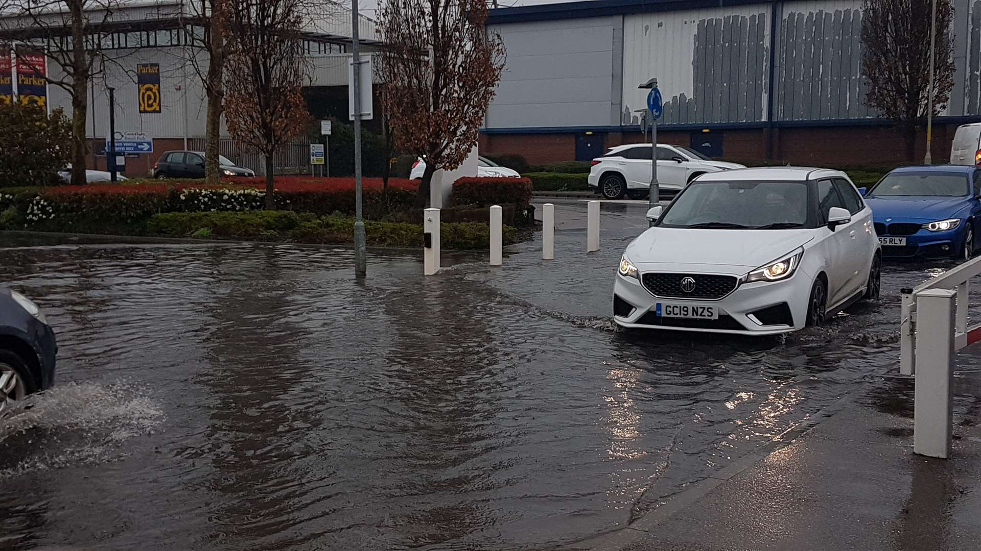 Motorists risking entering the flooded car park