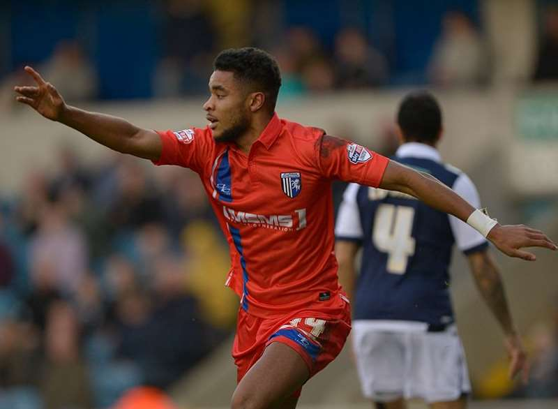 Dominic Samuel celebrates scoring Gills' first against Millwall