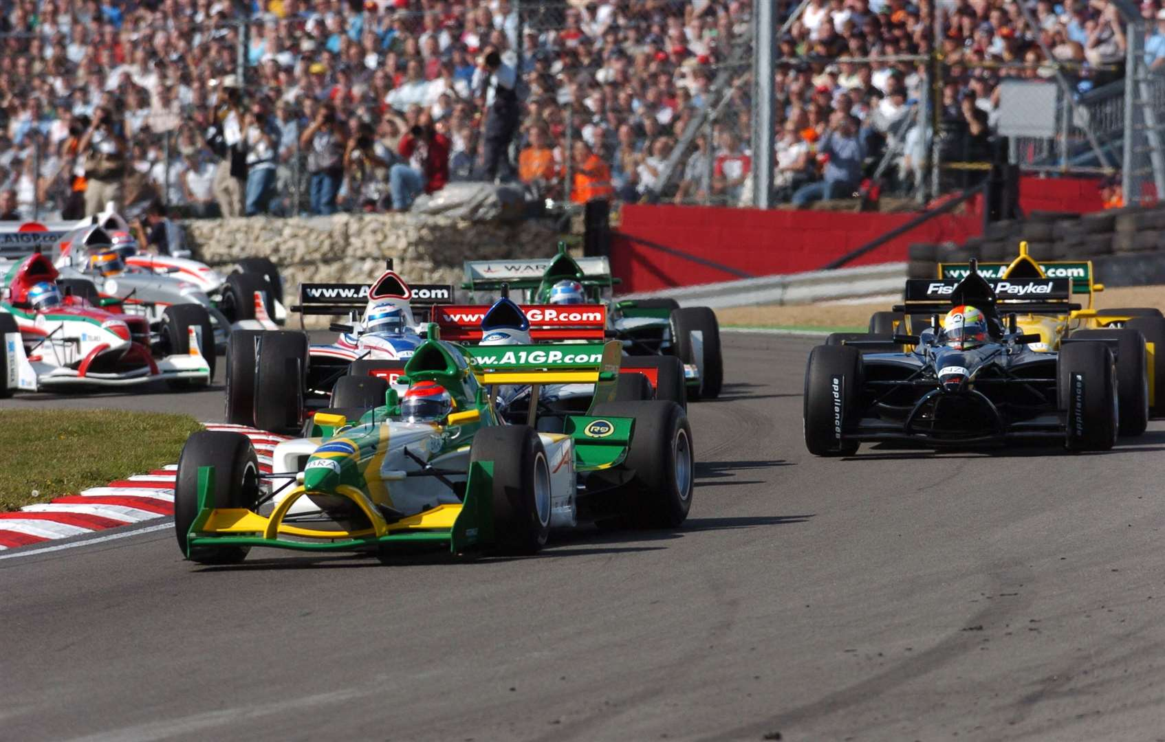 Nelson Piquet Jr leads the field into Paddock Hill Bend in 2005. Picture: Barry Goodwin