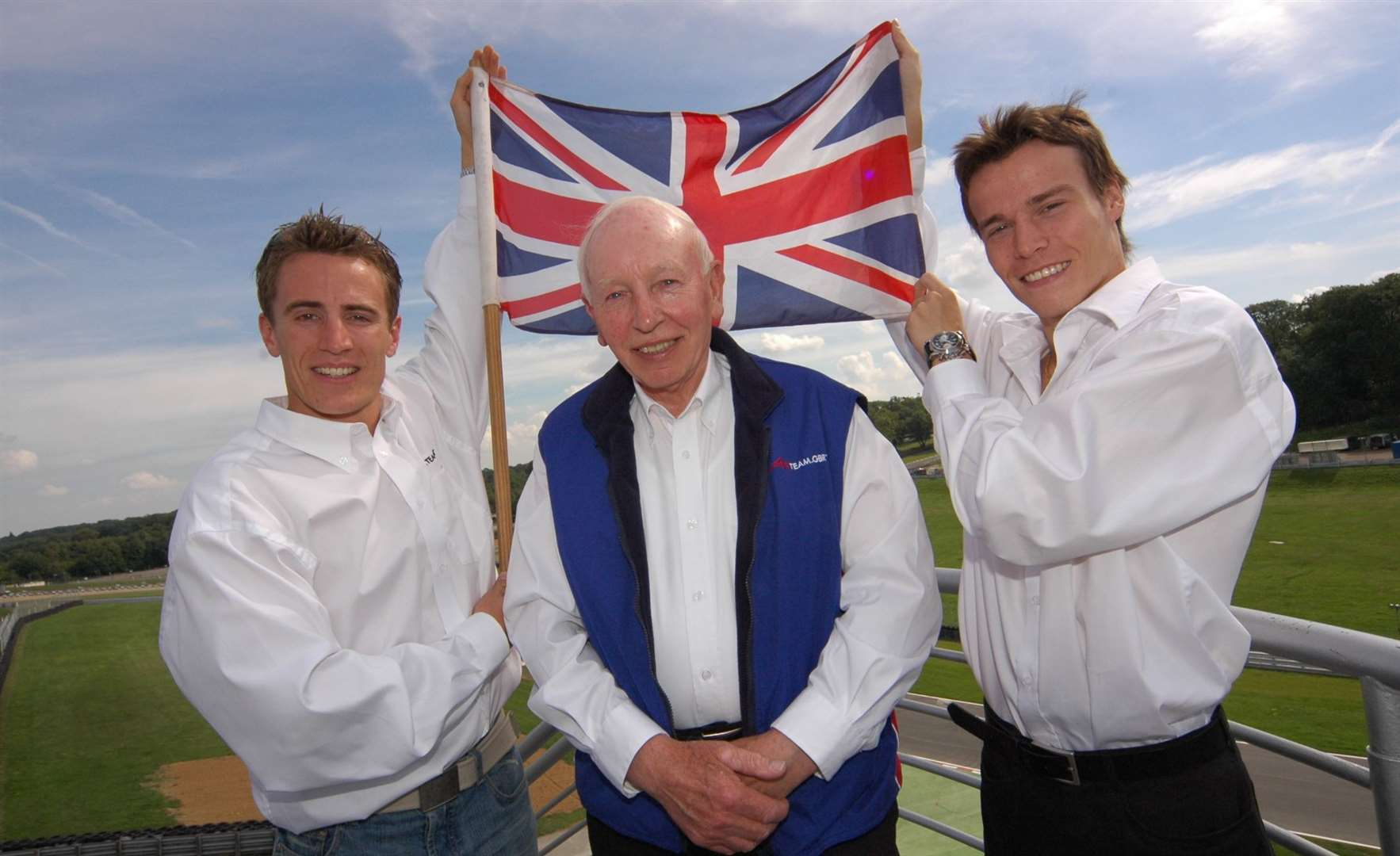 A1 Team GBR boss John Surtees with drivers Robbie Kerr and Alex Lloyd at Brands Hatch in 2005