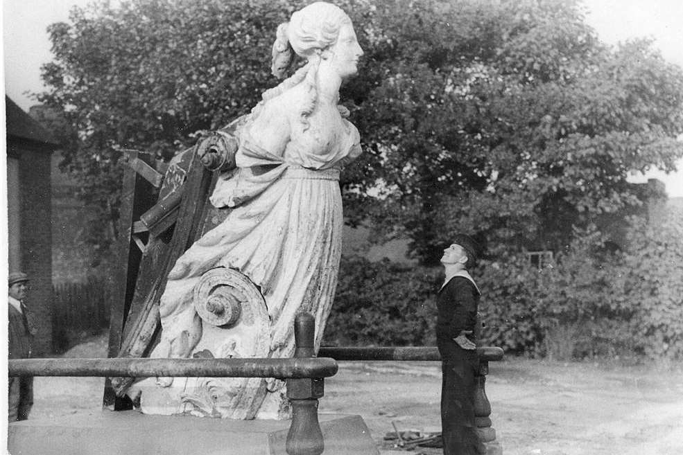 A sailor admires the Arethusa figurehead long before her restoration. Picture: Mary Stevens.