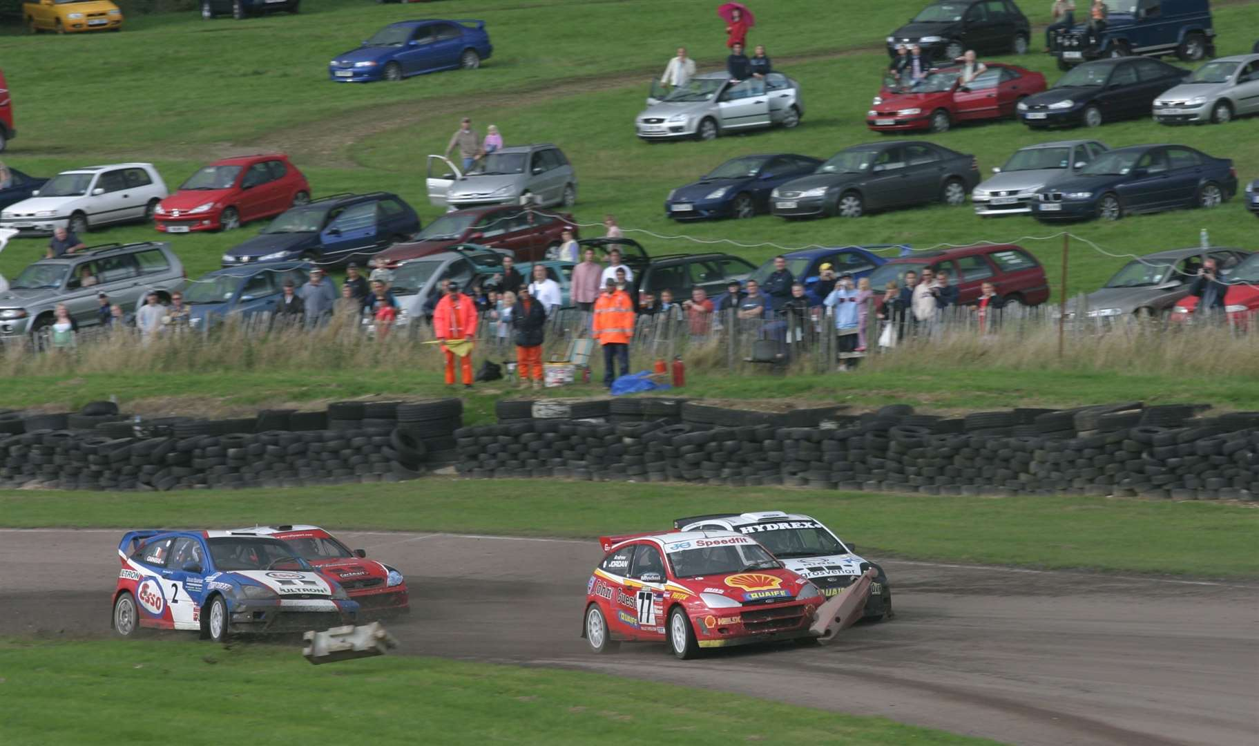 Andrew Jordan (77) sends the course markers flying as he sweeps past Pat Doran, while Dermot Carnegie (2) and John McCluskey dispute fourth place in the British Rallycross 'A' final at Lydden in August 2006. Picture: Kerry Dunlop