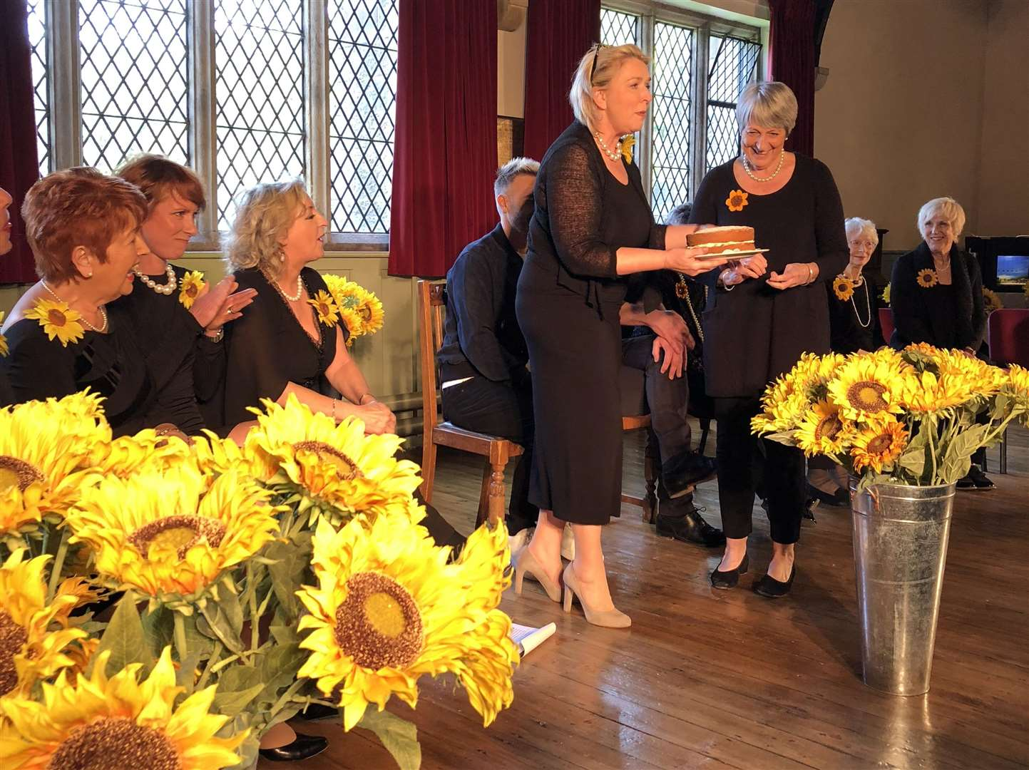Fern Britton is presented with a cake by one of the original Calendar Girls (2043548)