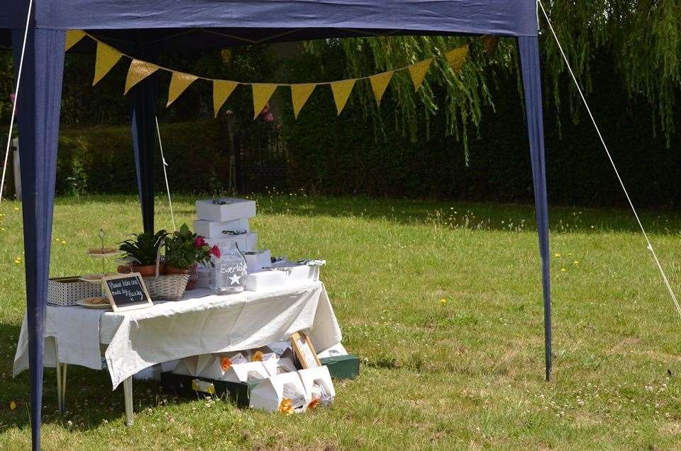 A stall was set up in the centre of Warehorne for people to get their cream tea packages. Picture: Jessie Banach