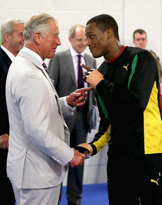 Chev and Prince Charles exchange a joke during a training session at the Games in Glasgow.