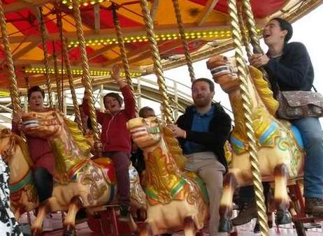 Some of the first visitors enjoy the Gallopers