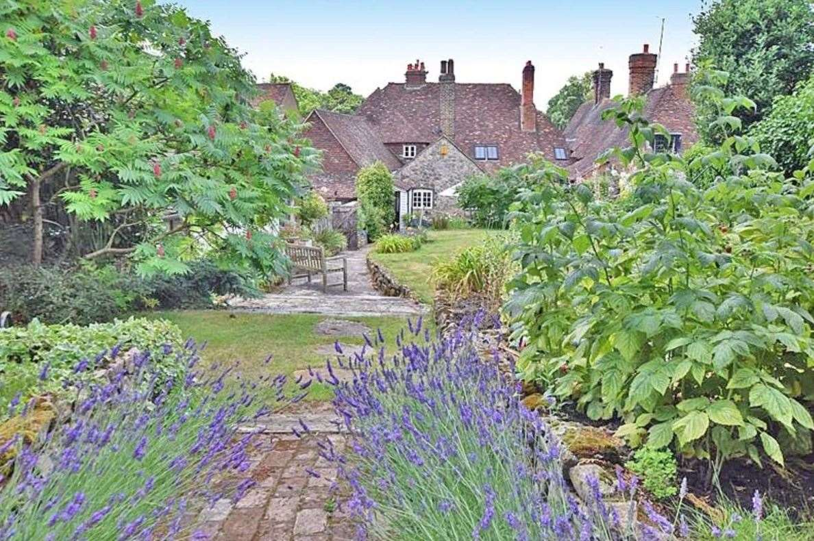 The walled cottage gardens include an extensive paved sun terrace, 'ideal for alfresco dining'. Picture: Zoopla / Ferris & Co