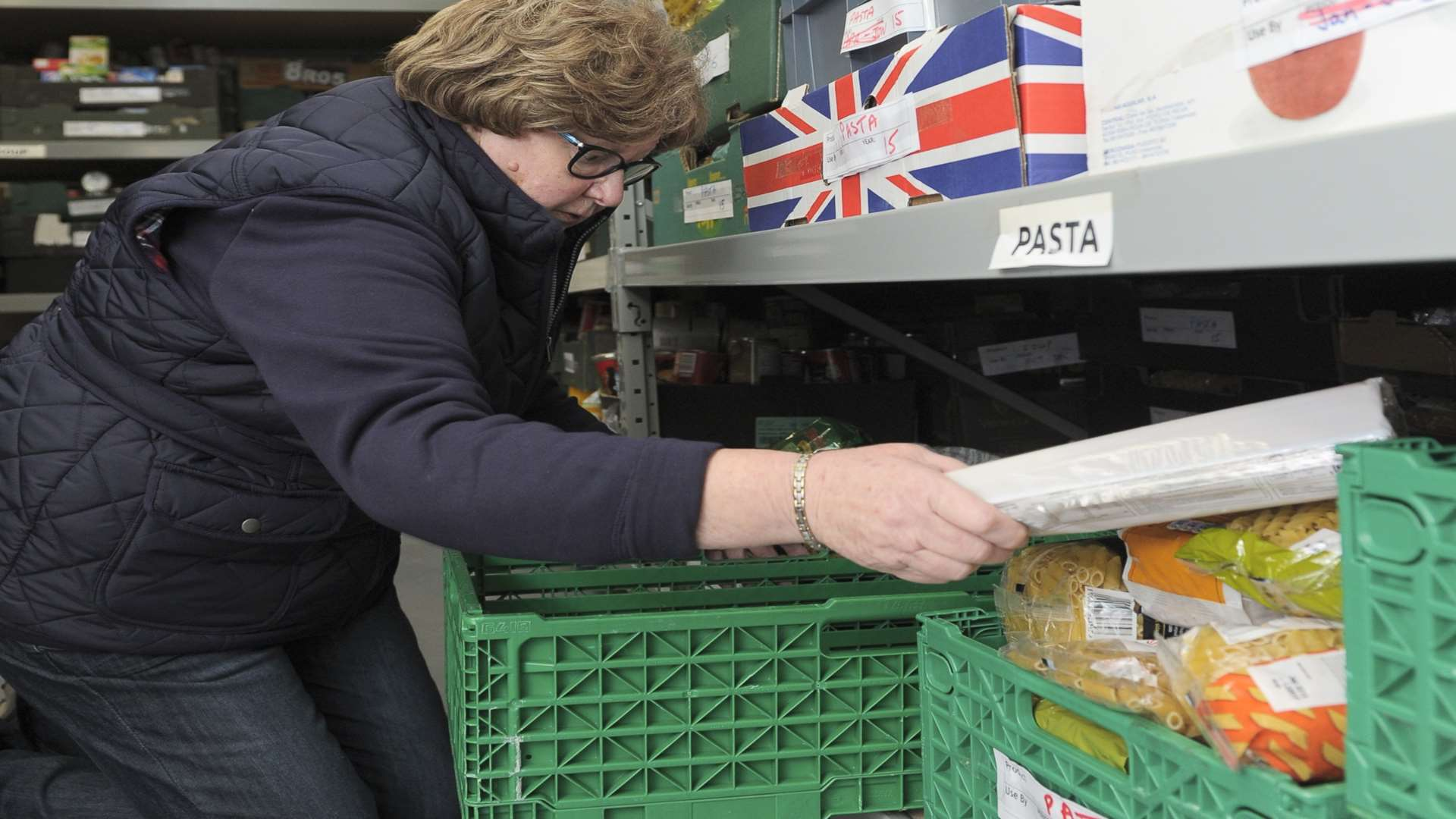 Sandra Wyatt stacking shelves at Medway Foodbank. Picture: Andy Payton