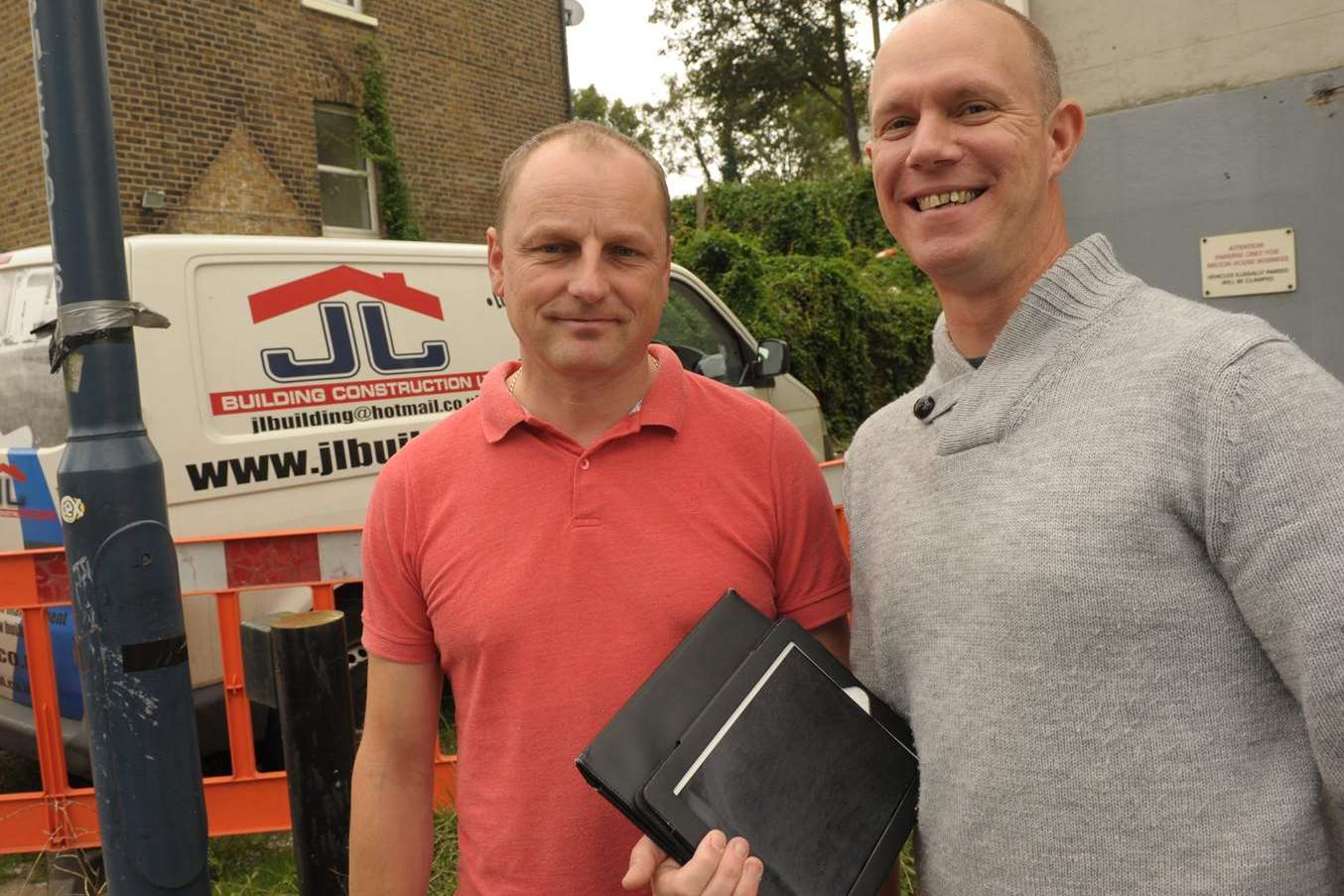 Builder Jarek Luszcz, left, who helped architect David Meaney recover his stolen iPad
