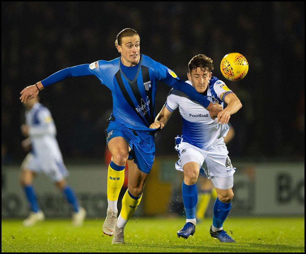 Gillingham striker Tom Eaves battles for the ball Picture: Ady Kerry