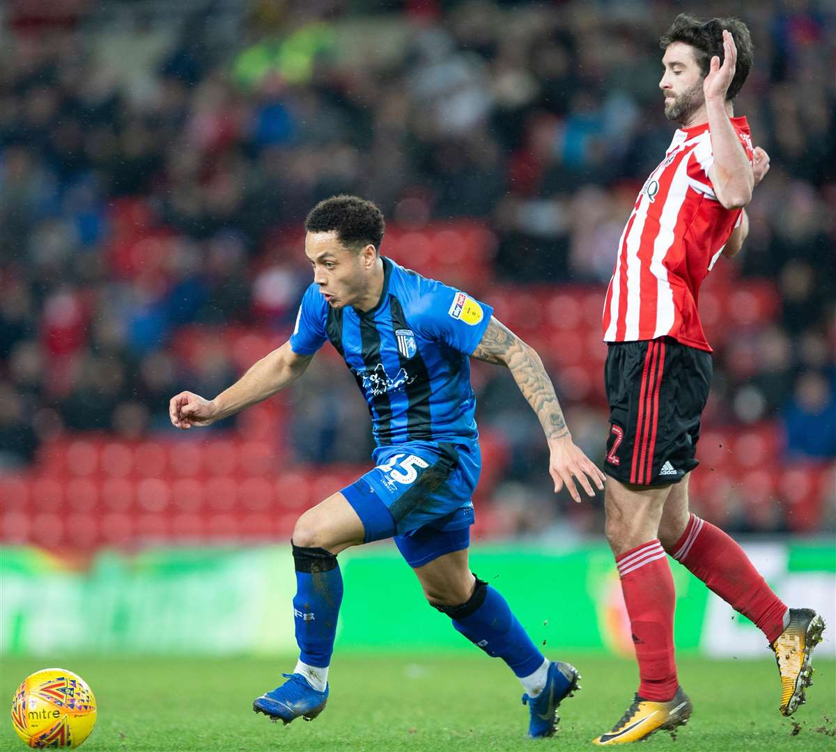 Substitute Elliott List skips away from Will Grigg Picture: Ady Kerry