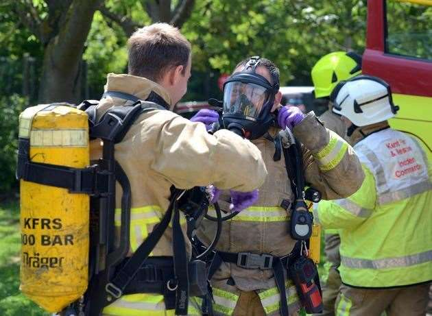Firefighters wore breathing apparatus for this incident. Library picture