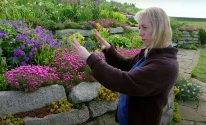 Linda Ford shows the pink seathrift which was moved around at the beginning to allow space for more planting. Picture BBC