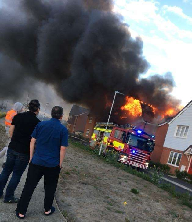 The fire has ripped through at least two homes