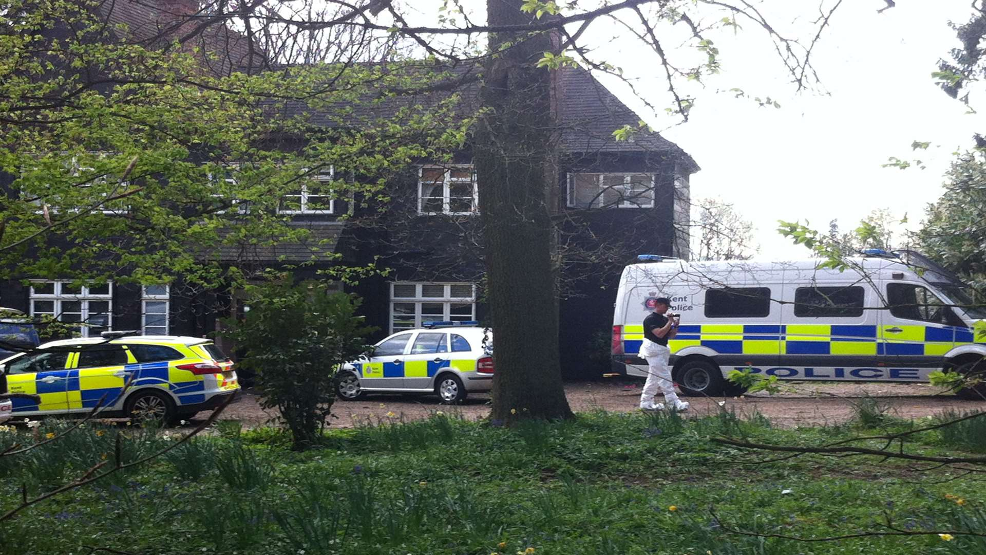 Police take pictures in the grounds of Peaches Geldof's home. Picture: Kiran Kaur