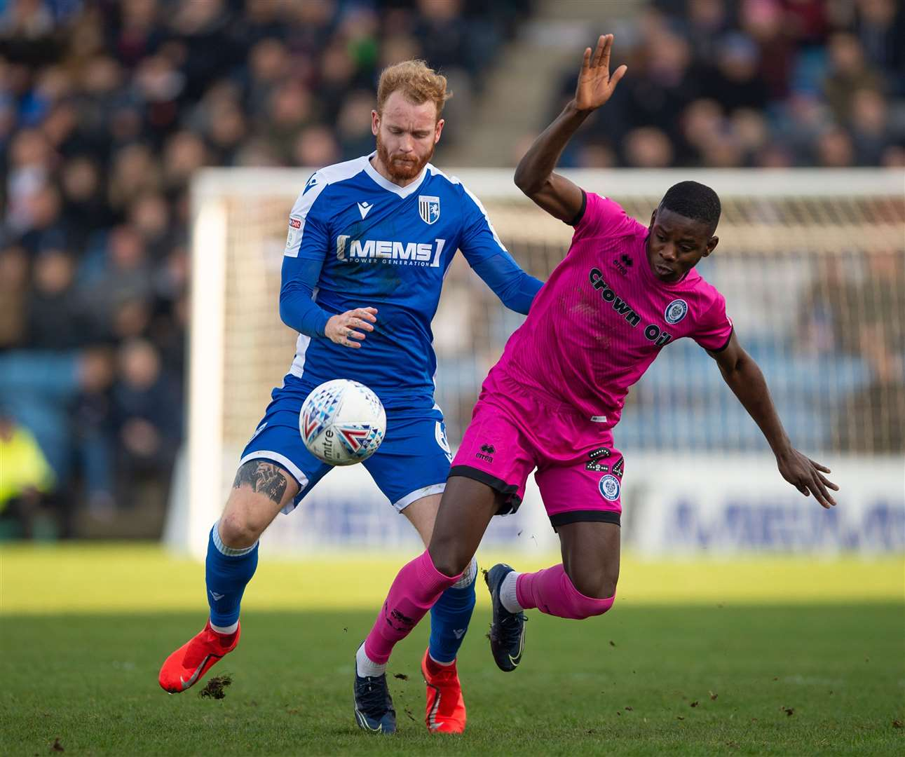 Connor Ogilvie challenges with Rochdale's Kwadwo Baah Picture: Ady Kerry