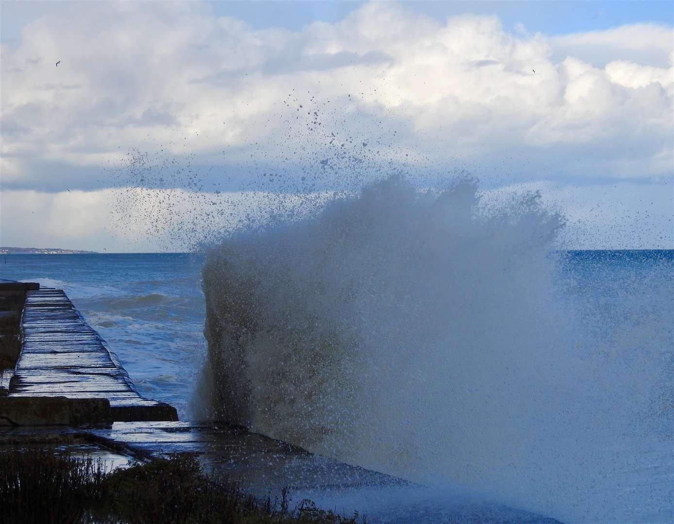 Fierce waves crash over the edge of a wall at Kingsdown Rifle Range Picture: Dean Macey