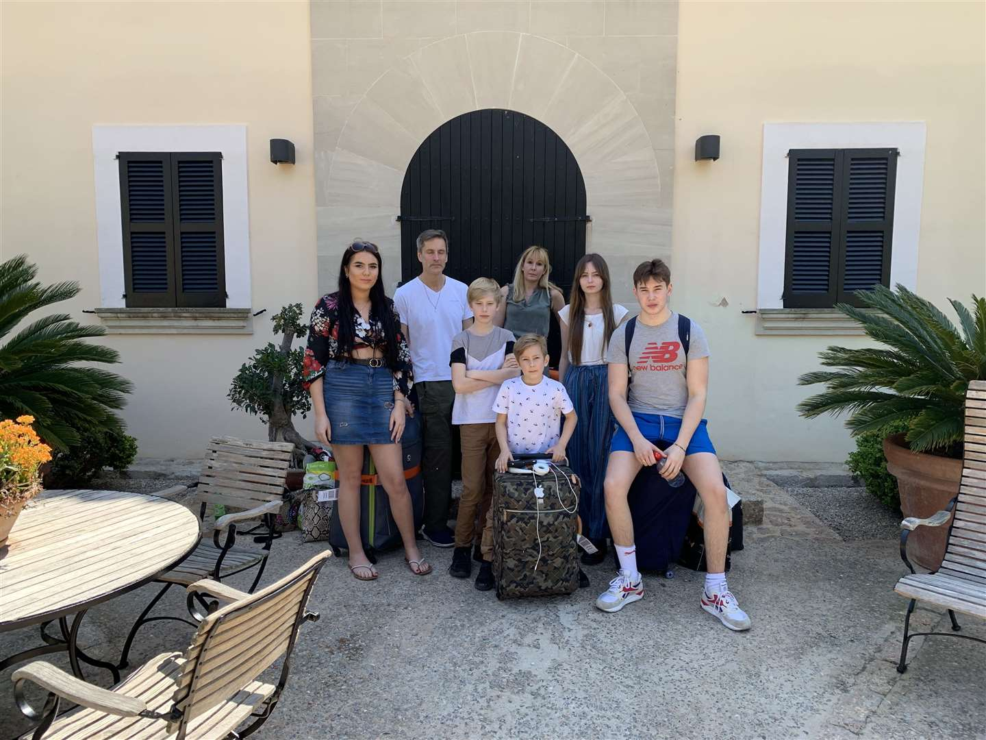 Angus Kennedy and his family outside the villa they expected to be renting. (8751015)