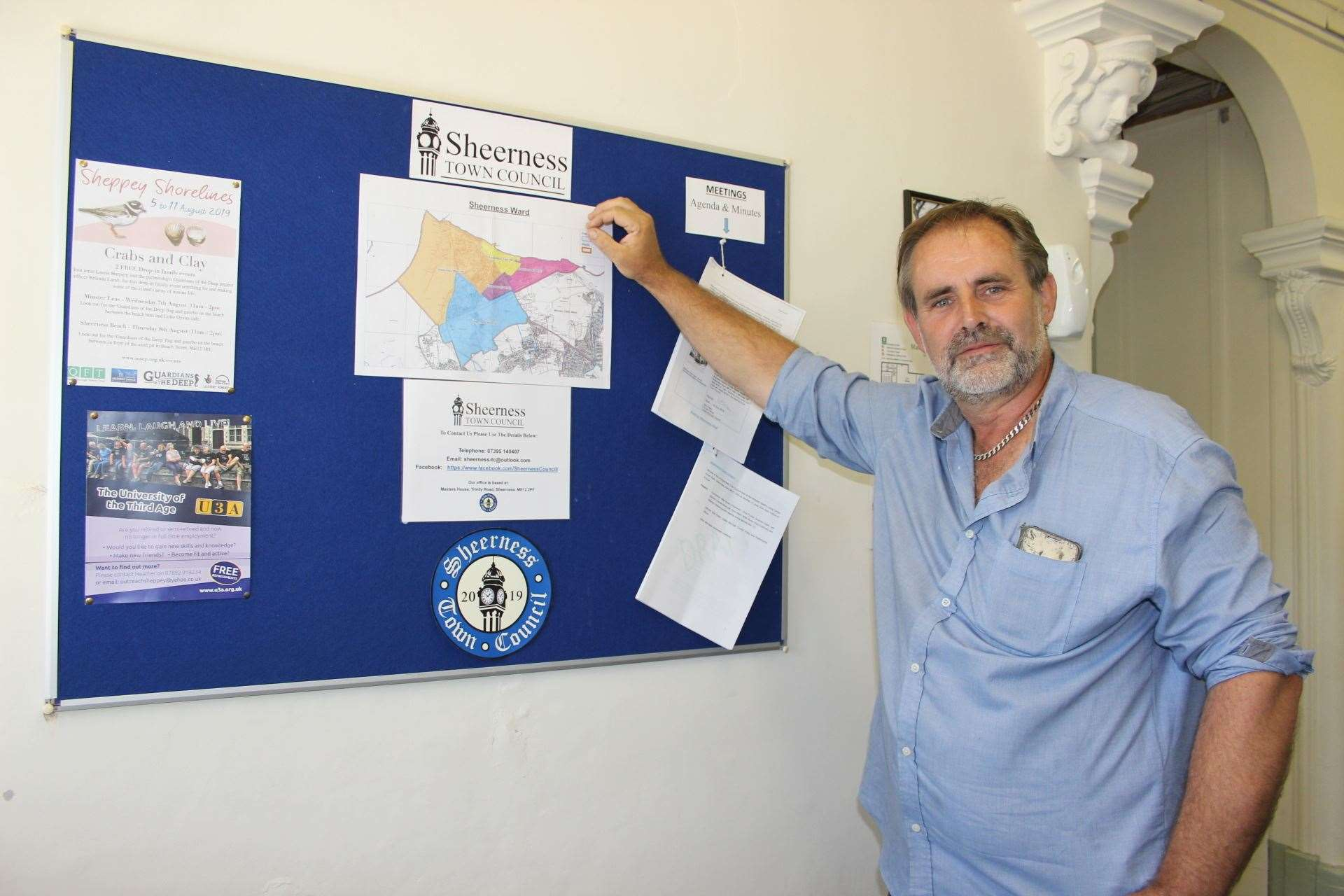 Sheerness Town Council chairman Matt Brown with the new notice board in the council offices in Trinity Road, Sheerness (15153549)