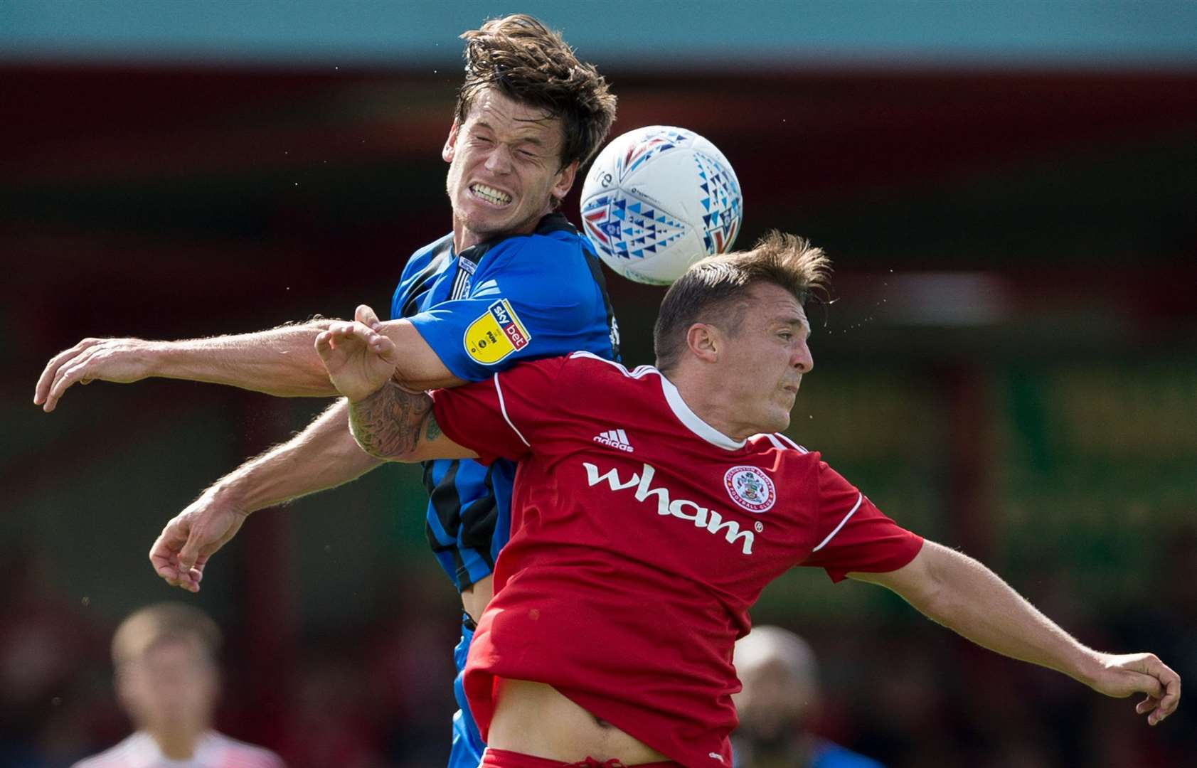Gills' Billy Bingham competes in the air with Scott Brown. Picture: Ady Kerry