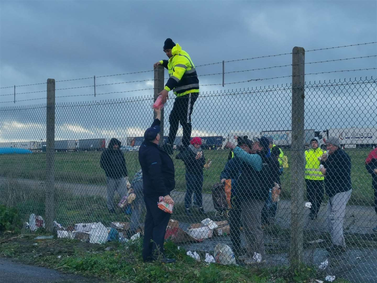 Food is passed to lorry drivers stranded at Manston Airport (43712598)