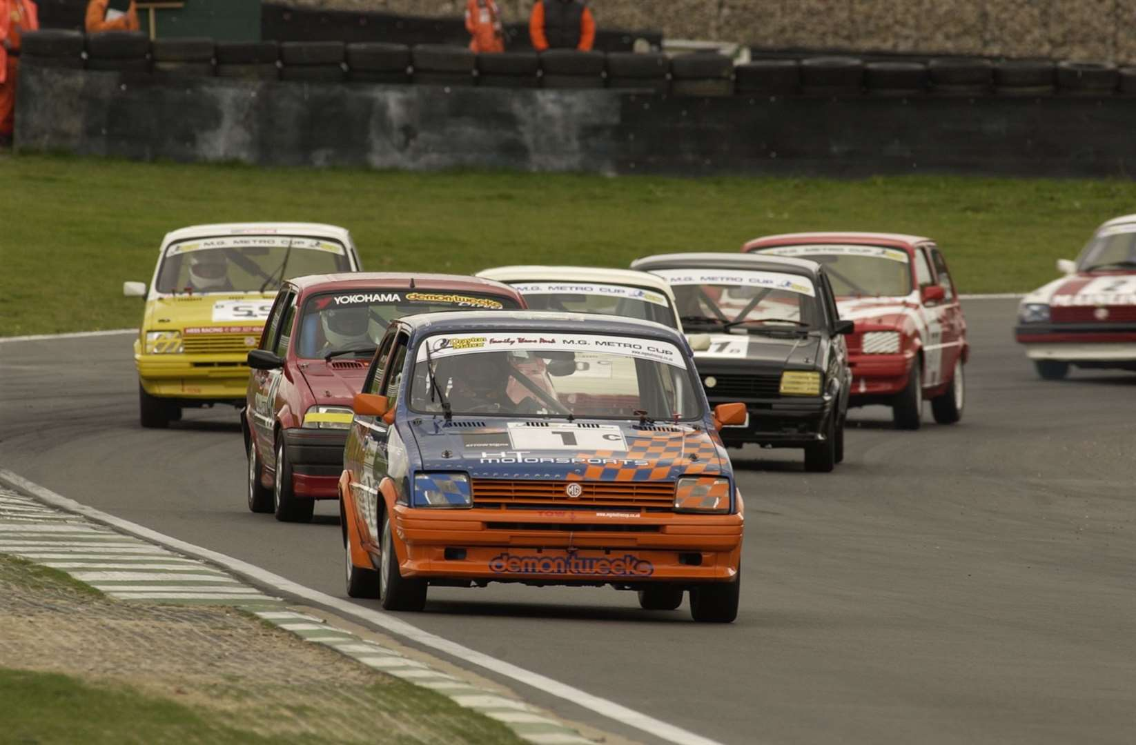 An MG Metro Cup pack charges along the Cooper Straight at Brands Hatch in September 2002. Picture: Andy Payton