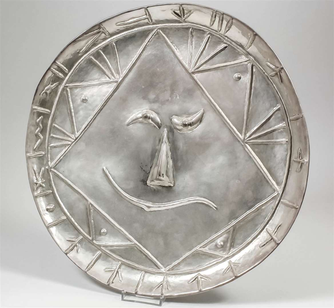 A silver repousse plate by Pablo Picasso sold for £28,000