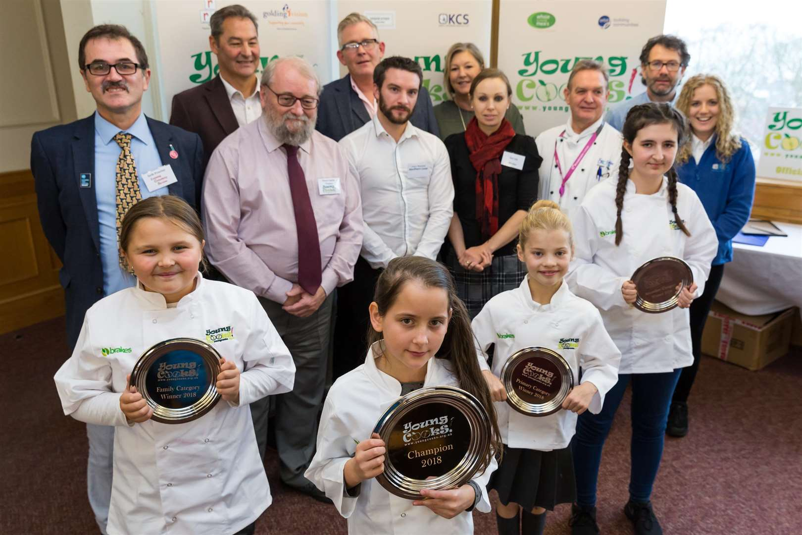 Front row (from left) Young Cooks 2018 winners Brooke Keen, Boglar Bote-Godri, Amelia Phillips, and Amelia Page with judges and supporters of the contest.